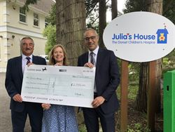 Acheson Directors deliver charity cheques following Kilimanjaro climb